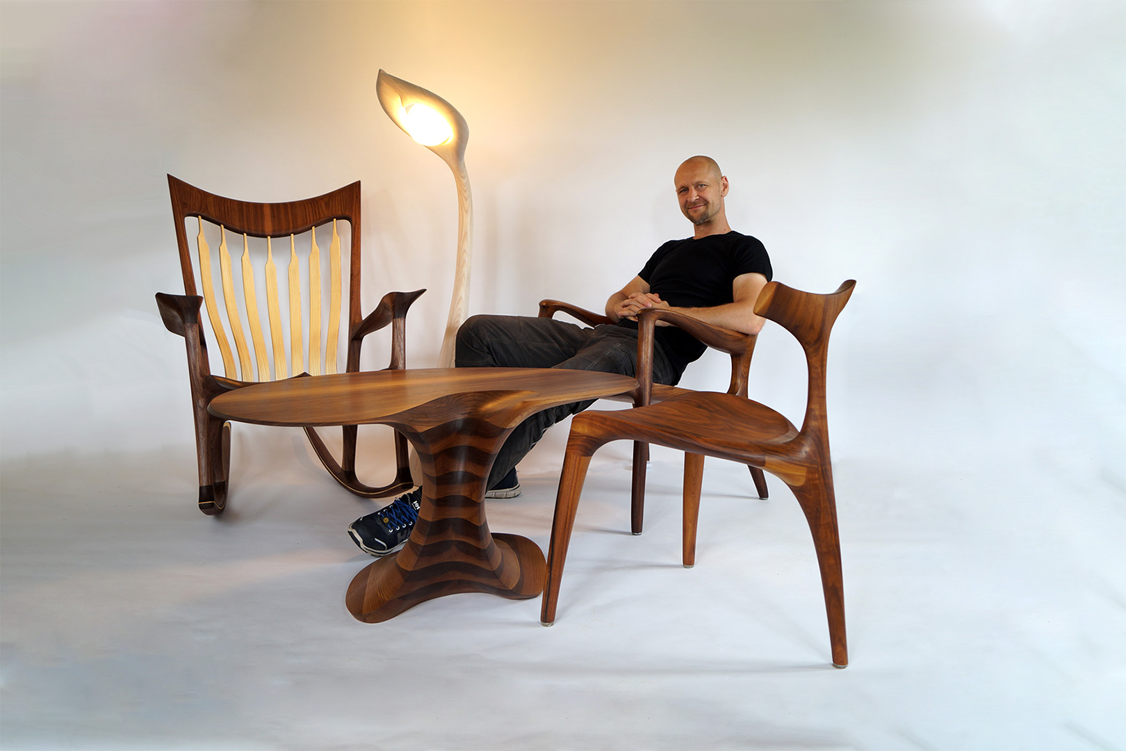 Morten with some of his most popular pieces: the American-inspired Low Rocker, the Low Back Lounge Chair and the Triplex Dining Chair, accompanied by the Sunflower light and his Columnae table.