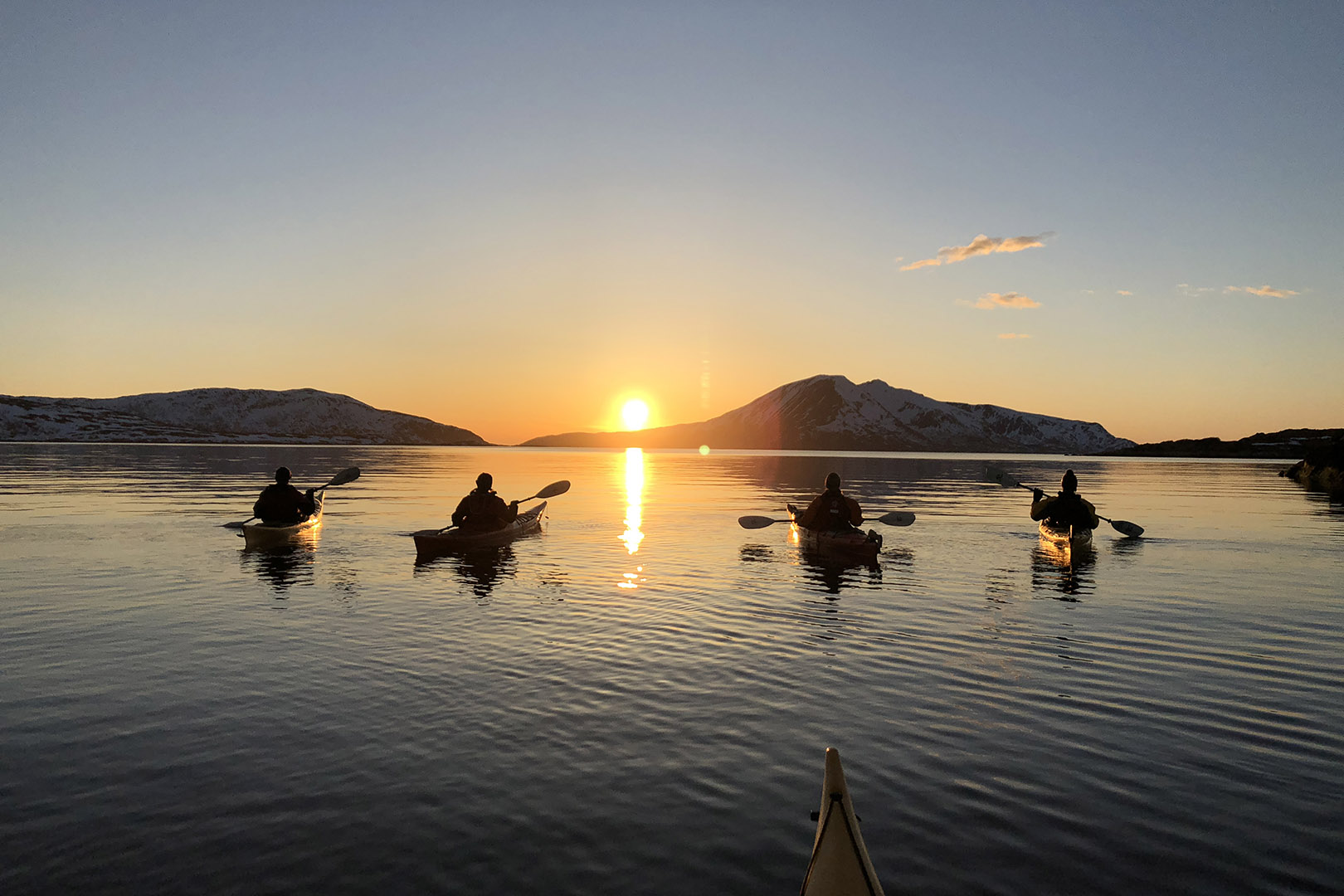 Visit Karlsøy kayaking sunset photoy by Elements Arctic Camp